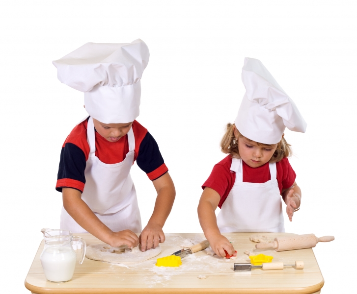 children-making-cookies-dressed-as-chefs
